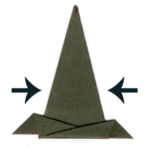 Origami Witch's Hat This spooky witch's hat is a little tricky to make - although to simplify the model we have suggested using a pair of scissors (which is, strictly speaking, cheating!) You can use if flat or standing (with its own built-in stand).