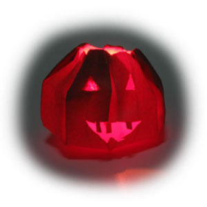 origami jack-o-lantern for Halloween with light turned off