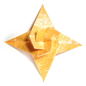 Front view of four-pointed spiral origami paper star